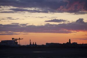 Sunset over Barrow in Furness town and shipyard, Cumbria, UK.